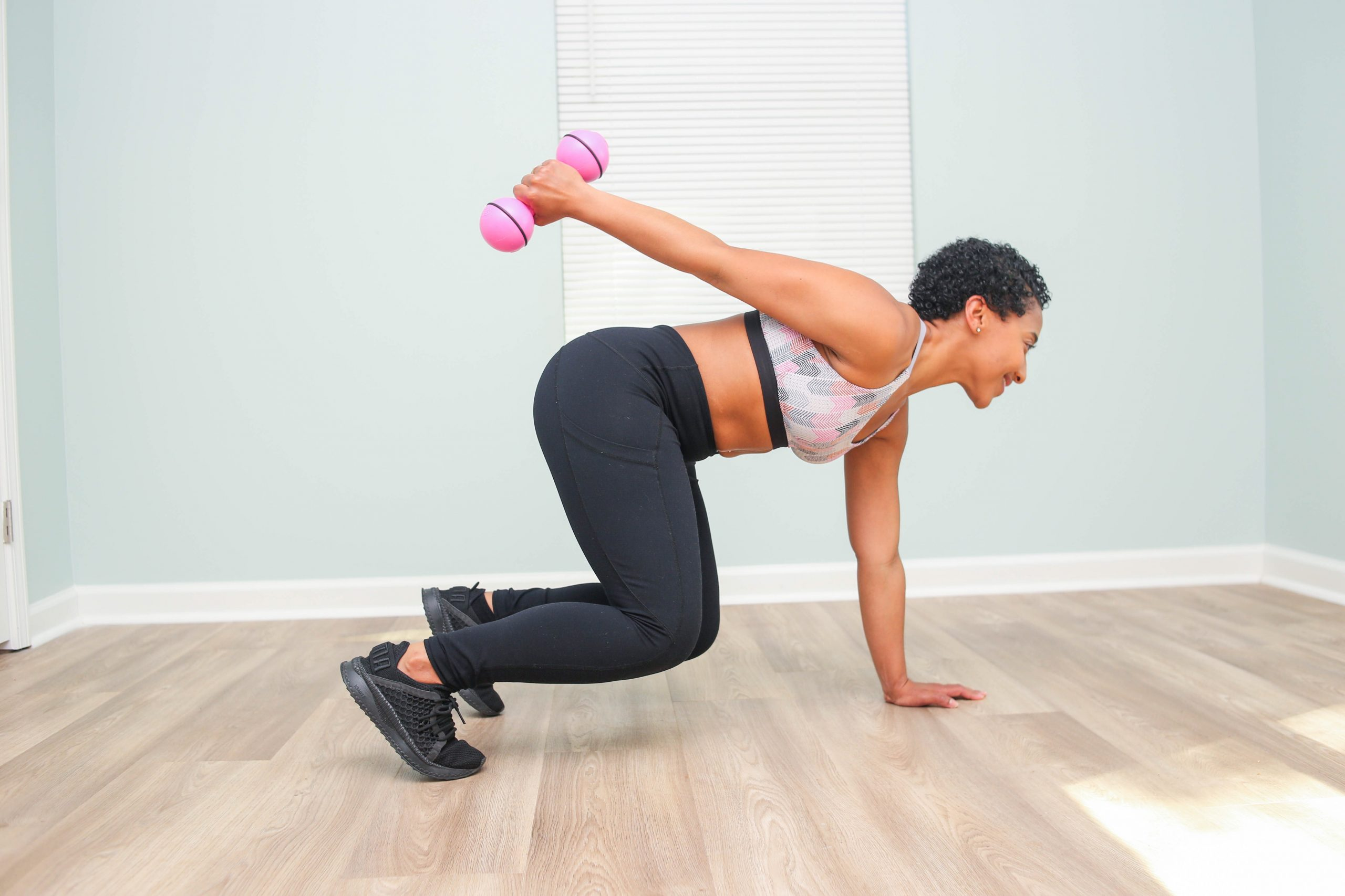 black woman working out: get fit during quarantine